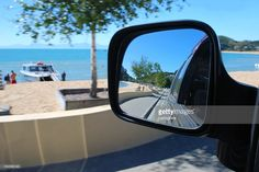 Looking at the view from a car mirror. The scenery surrounding is Kaiteriteri Beach in the Abel Tasman National Park, New Zealand in blur. Selective focus is on the view in the reflection. Car Mirror, Rear View Mirror, Abel Tasman National Park, The World Race, Reflection Photography, Kiwiana, New Zealand Travel, Travel And Tourism, National Parks