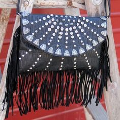 "Rhinestone Cowgirl Fringe Purse Western Handbag by Red Barn Ranch. $51.99. Measures: 10""long x 6.5""high x 2""wide. Black faux croc body with black fringe.. The edge of the flap has small belt tip conchos,. Rhinestones and studs decorate the front flap,. Wristlet handle or shoulder strap. Rhinestone Cowgirl Fringe Purse Western Handbag This purse is gorgeous, rhinestones and studs decorate the front flap, the edge of the flap has small belt tip conchos, Black faux..."