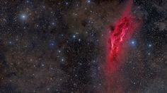 red galaxy picture in space