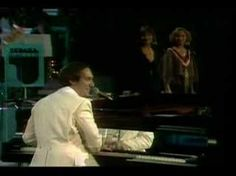 Neil Sedaka performs 'Laughter in the Rain'. Year unknown, but looks to be about the time the song was released (1975). And THIS is the way to do a live version of a song that has orchestration in it...by including the orchestra. Classic and classy.