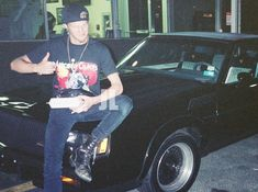 Layne Staley sitting on a Buick Grand National
