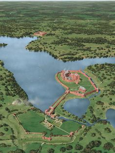 Kenilworth Castle as it might have appeared in about 1420, showing John of Gaunts work, and Henry Vs newly built Pleasance in the Marsh at the top of the mere