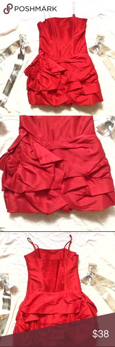 Red Single Ribbon Strap Cocktail Dress! Measures 30 bust, 28 waist and 38 hips. Brand new! Has beautiful fabric flower on top of ruffles! Elastic on back for precise fit! Boning along the bust for shape! Nylon and poly blend! Dresses