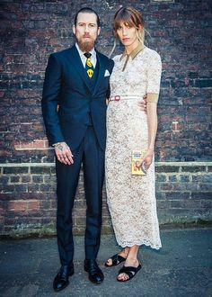 Most fashionable couple Justin O'Shea and his smiley face tie and Veronika Heilbrunner in lace and flat sandals. #NYC