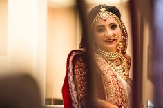 A bride can never go wrong with traditional shades of red and gold....  Indian Bride Preparation | Beautiful Pictures | Stunning & Unforgettable Moments