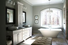 Master bath of the Richelieu Plan 1157 www.dongardner.com - one  wing is dedicated primarily to the master suite. With two large walk-in closets, porch-access, a luxurious master bath and a sitting space with shelves and fireplace, the master suite is truly remarkable. #Bathroom #Tub #Bath