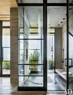 An airy oceanfront Malibu, California, home is equipped with a rain shower by Dornbracht.