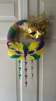 mardi gras wreath - beads wrapped around foam wreath and masks from DT Mardi Gras Wreath, Mardi Gras Beads, Mardi Gras Party, Mardi Gras Centerpieces, Mardi Gras Decorations, Fall Crafts, Diy And Crafts, Carnival Cupcakes, How To Make Wreaths