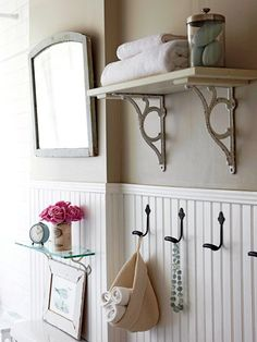 Boost the storage options of a small guest bath with shelving and hooks. Attach easy-to-assemble bracketed shelves to walls to help keep the countertop clutter-free. Install a row of hooks to keep towels and robes off the floor.