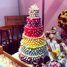 Rainbow Meringue Kiss Cake... For some serious colour lovers, this is the Fondant Fox and Meringue Girls Rainbow Tiered Wedding Cake, adorned with mini meringue kisses.