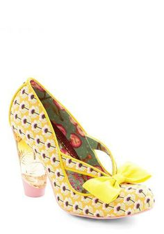 Unique in New York Heel in Yellow   Paired with a bold red frock, polka-dotted tights, and a fascinator, these cute heels announce your panache to passersby!