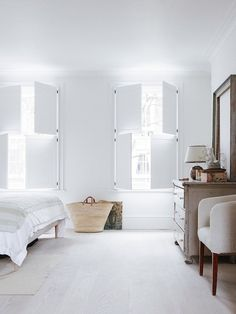 T.D.C | Beautiful bedroom shutters + Dinesen flooring. Photo by Rory Gardiner