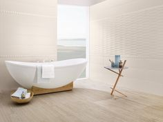 Villeroy and Boch Flowmotion wall tiles and Natureside wood effect floor tiles.