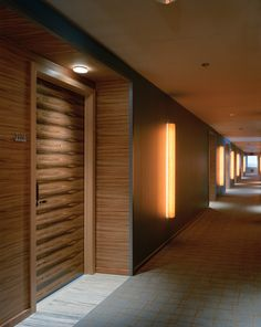 Luxurious Paldao wood embraces all 22 stories of the hotel. Hotel Hallway, Hotel Corridor, Hotel Door, Corridor Lighting, Corridor Design, Hotel Carpet, Hallway Designs, Hotel Lobby, Luxury Apartments