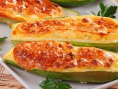 Easy zucchini recipes like this Zucchini Stuffed With Cheese recipe make eating zucchini flavourful . Main Course Dishes, Vegan Main Dishes, Veggie Dishes, Pasta Dishes, Easy Zucchini Recipes, Vegetable Recipes, Baked Stuffed Zucchini, Baking Recipes, Real Food Recipes