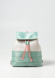 Seatbelt Backpack Colorblock Mint and Peach. Bucket shape with grab handles, adjustable straps and drawstring. Made in the USA.