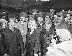 The star posing with troops in South Korea in 1954.