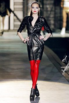 Model wears red stretch PVC pants with sleek black PVC  belted coat and black ankle boots.. DIY the look yourself: http://mjtrends.com/pins.php?name=red-stretch-vinyl-for-pants