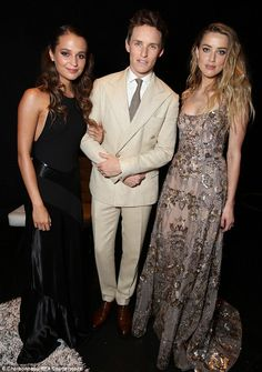 His leading ladies! Eddie Redmayne joined co-stars Alicia Vikander and Amber Heard at the Danish Girl premiere during the 40th Toronto International Film Festival on Saturday