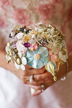 "brooch bouquet with hidden charms of dragonflies and a hot air balloon ""A little on the bling side but fun"""