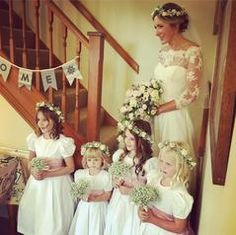 6979757c72a Flower girls in white dot cotton bridesmaid dresses and pink silk sashes by Amelia  Brennan Ivory