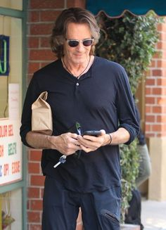 Rick Springfield Photos Photos - Musician Rick Springfield stops by a doctors office in Beverly Hills, California on June 27, 2016. Rick was all smiles as he left the building. Rick Springfield Stops By A Doctors Office
