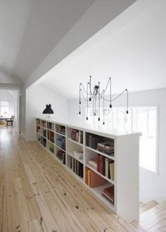 bookshelves built into stairway wall