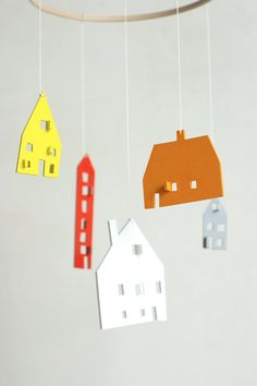 This wooden house mobile is made by the drawing of my 10 year son.  Houses are laser cut from natural wood veneer and carefuly handpainted. You can