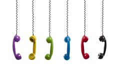 Multi Colored Handset Pieces Suspended By Stock Photo (Edit Now) 106528739 Wind Chimes, Photo Editing, Royalty Free Stock Photos, Image, Cord, Phone, Editing Photos, Cable, Telephone