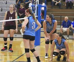 Waiting for the serve are Lyons senior Abby Shields (12) and Gananda players Morgan Hart (3), Heather Prinsen (10) and Peyton Wyjad (9).