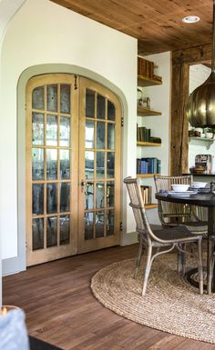 Episode 15 - The Giraffe House - Magnolia Market...Those arched doors are amazing! They installed rustic mirrored glass to hide the contents of the pantry.