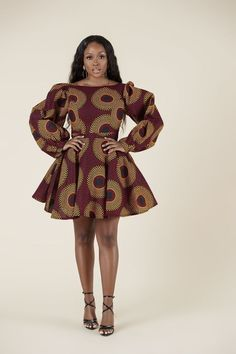 The stunning pink and gold pattern does the talking here, ensuring heads will be turned when you walk by! T-shirt sleeves give this gorgeous dress a relaxed vibe, making it more low-key and wearable. African Fashion Ankara, African Print Fashion, African Wear, African Attire, Africa Fashion, Tribal Fashion, African Style, African Prom Dresses, African Dresses For Women