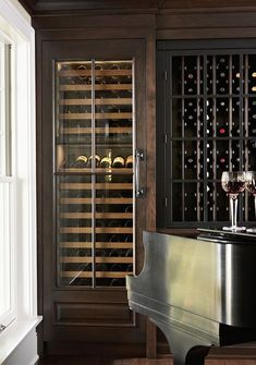I will have Corey make this in our kitchen!!     Home wine bar by Casa Verde Design  Wine storage frig with 2 lower drawers