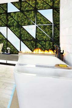 Designer Michele Alfano surrounds the DXV Modulus Freestanding Soaking Tub and matching Tub Bridge with nature. A living moss wall, concrete  replace and warm wood tones bring a sensorial experience to her Modern Copenhagen #DXVDesignPanel bathroom. The DXV Modulus Collection is available in November 2017.