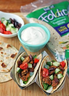 These easy Greek Chicken Tacos are packed with fresh flavor, seasoned chicken & a Feta-yogurt spread for 138 calories or 3 Weight Watchers SmartPoints each!