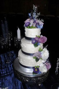 This whole wedding was georgeous decorated in all blues and purples. This 3 tiered buttercream cake was adorned in flowers and ribbon with a bit of white scrollwork done on the cake