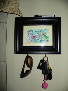 wooden picture frame, child's artwork, mat, dry erase marker, and some cup hooks. Within 5 minutes I had a functional piece of art that I can write things I don't want to forget on the way out (like diapers for preschool, etc). Love it!