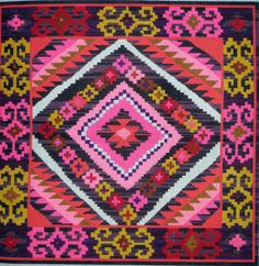 Kilim One 70280 from Unique NZ Designs: The picture is 16.25 inches by 16.25 inches. The canvas including the printed area is 21 inches by 21 inches.   13 mesh handpainted needlepoint canvas.  NEEDLEPOINT THREAD NOT INCLUDED $181.80