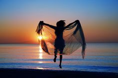 http://www.djmysticalmichael.com/wp-content/uploads/2013/01/woman_sunset_sea.jpg