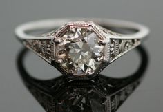 n amazing example of finely crafted intricate filigree! This 18 K white gold diamond ring has a stunning diamond in the center which is over a carat!