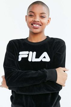 Sporty-luxe pullover sweatshirt in velvety velour made exclusively for UO by FILA. In a relaxed fit with long sleeves, a crew-neck and banded hems featuring plush allover texture and a logo applique at the front.