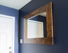 DIY Wood-Framed Mirror Tutorial: Learn how to make a wood frame for a bare mirror by following the steps outlined in this detailed tutorial.