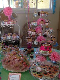 Makena's first luau birthday party - dessert table w/cupcakes, mini smash cake, sunglasses cookies, and Rice Krispie treat kabobs.