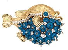 A Sapphire, Diamond and 18 Karat Gold Brooch