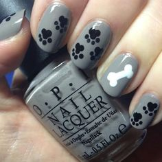 cool Pawprint and dog bone nail art.
