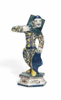 Dutch Delft polychrome Commedia Dell'Arte figure of a pilloried harlequin circa 1740, height: 23,5 cm., Christies Inc.