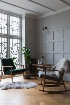 Grey panelling, feature windows, oak parquet floor and a rocking chair. What else could a girl ask for!