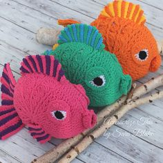 """Gus"" the Goldfish is the coolest fish in the sea! So many colour combinations make him perfect for home & nursery décor. Measuring approximately 2 feet and made with Bernat Blanket Bright Super Bulky yarn making him soft, cuddly and quick to work up."