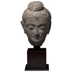 Gandharan Schist Stone Head of Buddha, 250 AD | From a unique collection of antique and modern sculptures and carvings at https://www.1stdibs.com/furniture/asian-art-furniture/sculptures-carvings/