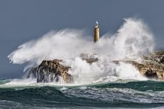 Isla Mouro Light gets battered by waves